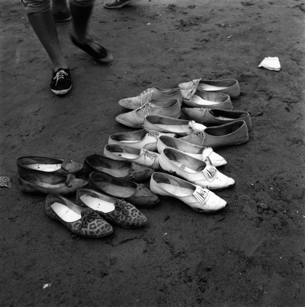 Shoes left on beach in preparation for Salish canoe races in North Vancouver, 1962