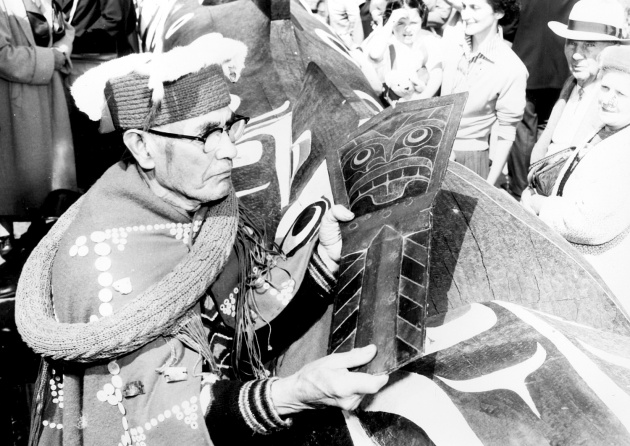 Chief Mungo Martin holds copper crest to be presented with the Royal Totem Pole to the Queen, 1958