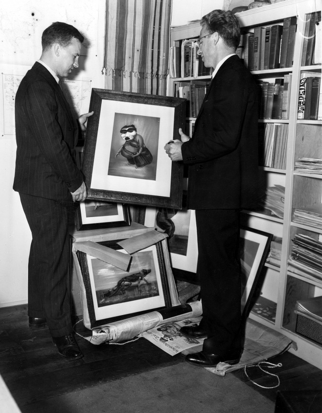 Henry Hawthorn unpacking paintings for the Museum of Anthropology, 1948