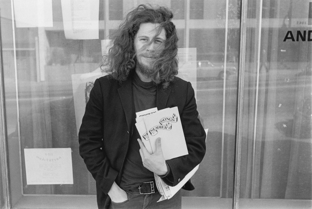 Ed Varney with his first book of poetry, Ed Varney, Michael de Courcy, 1970