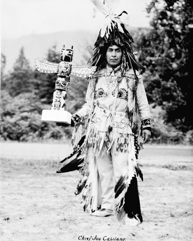 Matthias Joe (Chief Joe Capilano) with Totem Pole, circa 1930